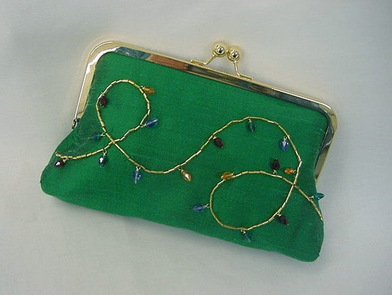 How awesome is this clutch?  Twinkling lights hand-sewn using Swarovski crystals!