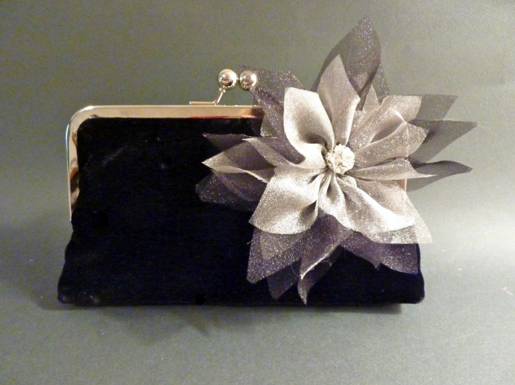 This hand-crated floral piece on this clutch really takes the clutch from classic to divine!