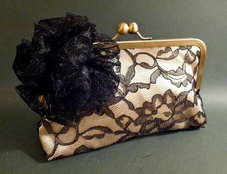 This delicate lace clutch would be ideal with your LBD at the holiday party!