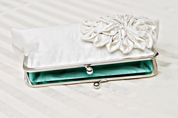 Karina also makes bridal clutches.  Looking for something blue?