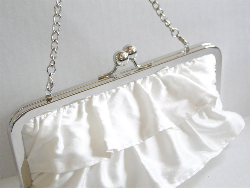 Pretty ruffled clutch with chain.