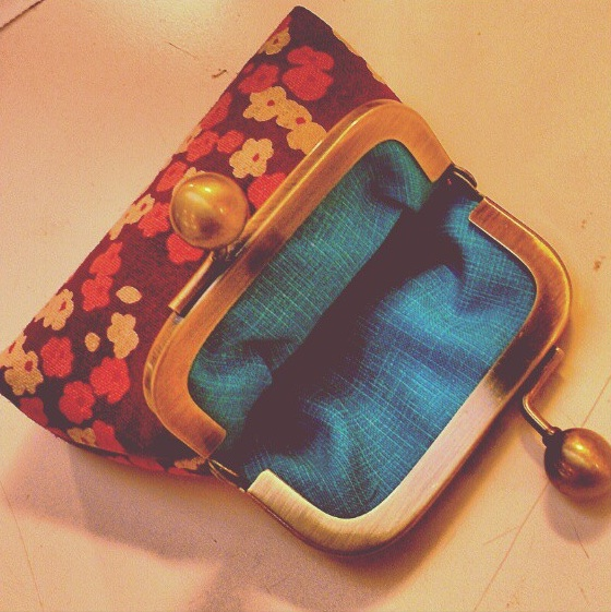 This coin clutch is made by Darci Bee