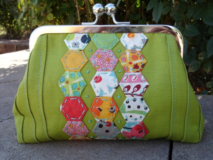 This clutch is made by Elaine.  A little bee brooch would be brillant!