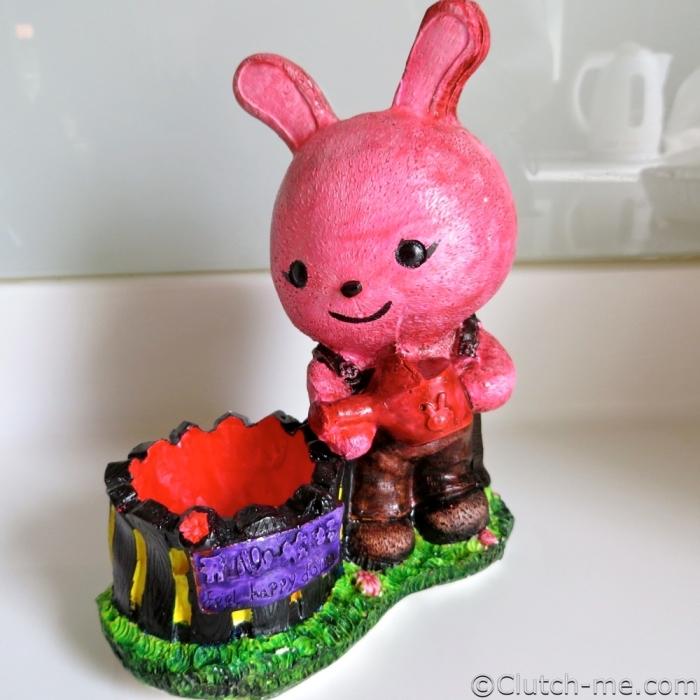 paint figurine bunny rabit water can