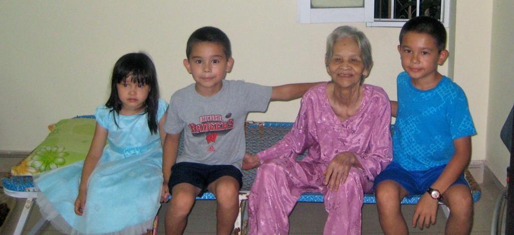 From April, 2012.  Hayley, Noah, Great-Gram Khuong, Ethan.